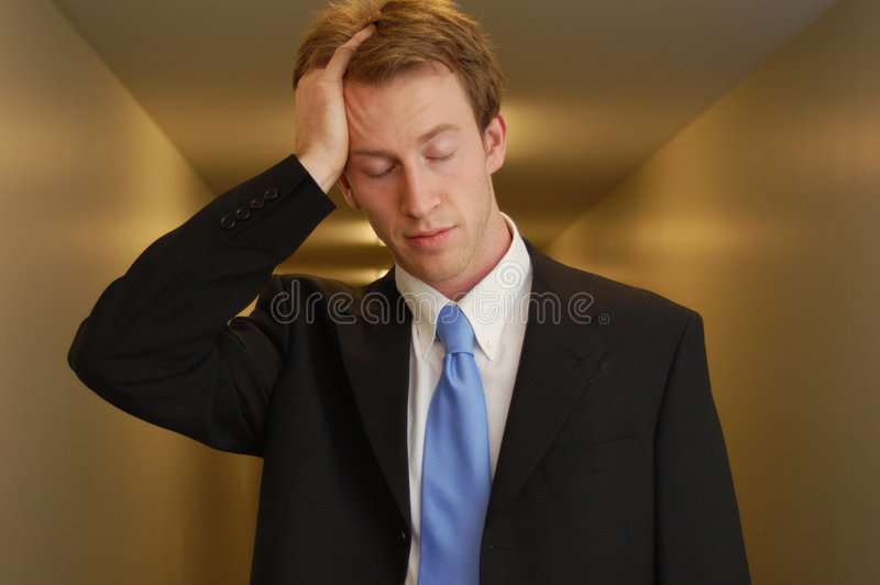 tröttat affärsmanhall arkivfoto