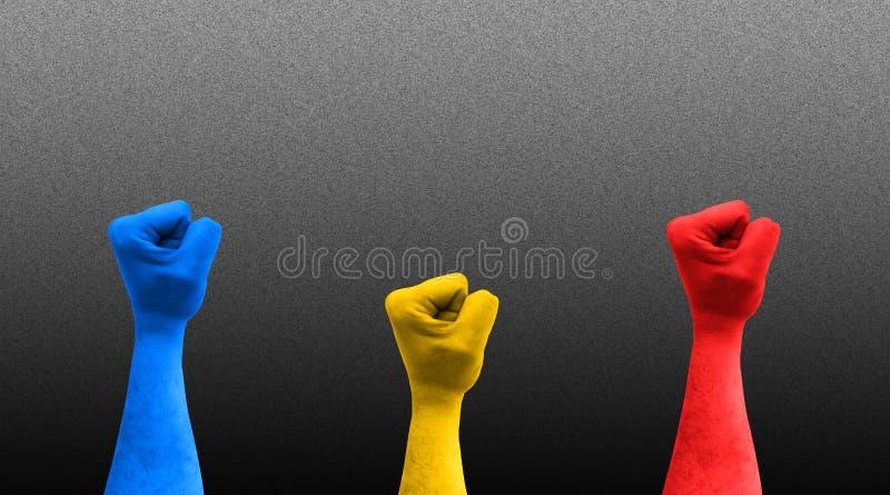 Tr?s punhos no ar com cores romenas da bandeira fotos de stock royalty free