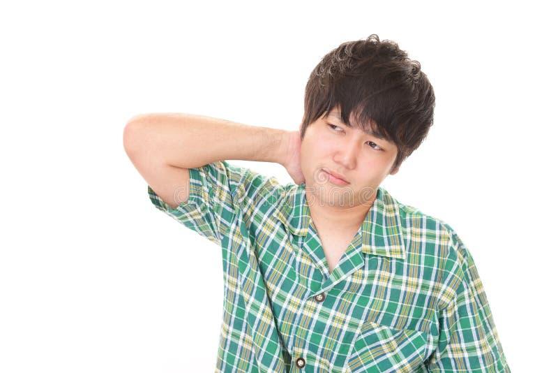 Tr?tt asiatisk man royaltyfri bild
