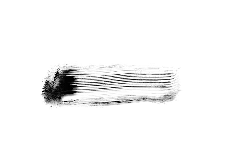 Traço de pincel preto sobre fundo branco imagens de stock royalty free
