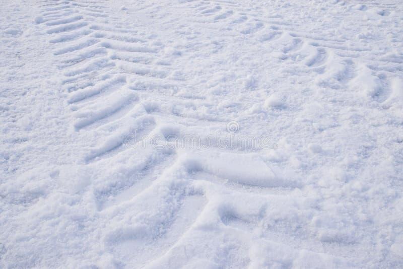 Traço do trator na neve fotos de stock