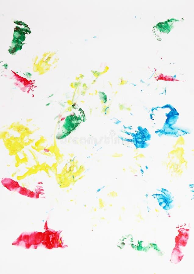 Traços das mãos e dos pés das crianças imagens de stock royalty free