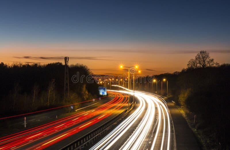 Traînées de lumière de voiture d'autoroute image stock