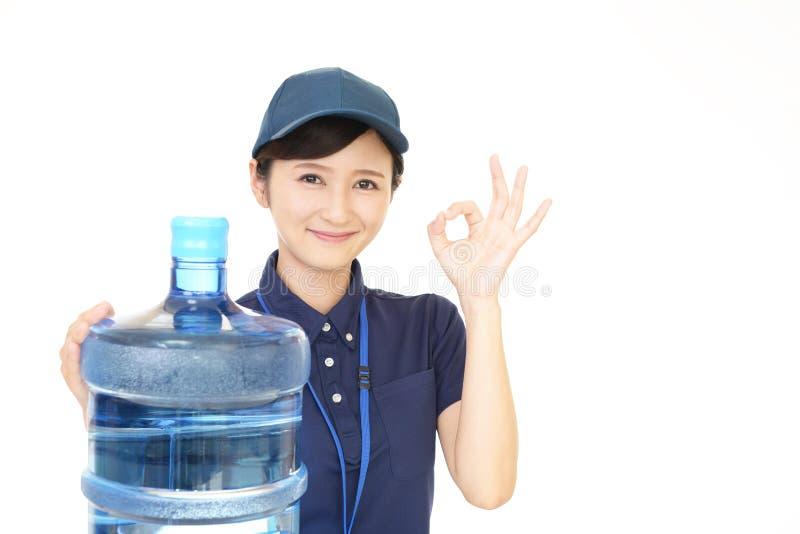 Trabajador asiático sonriente imagen de archivo