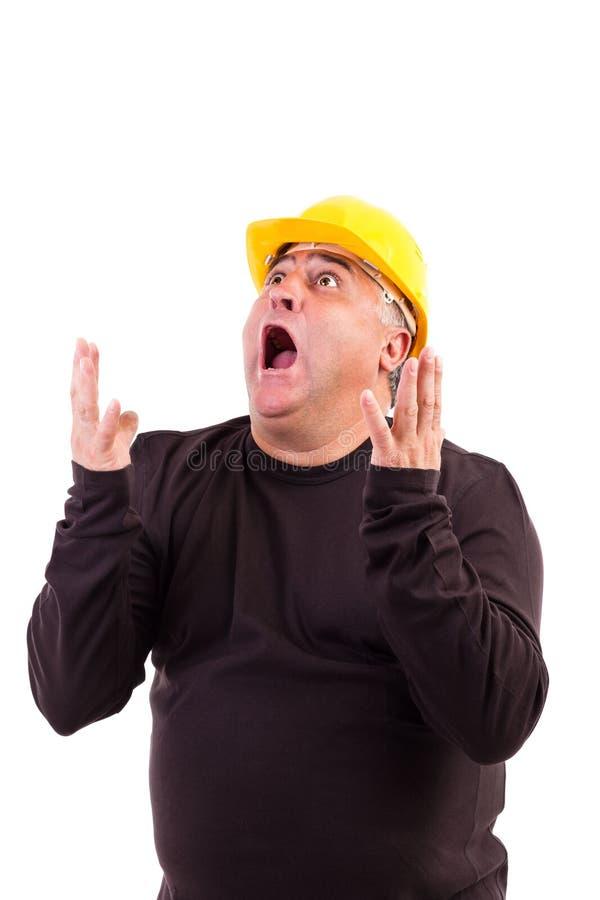 Trabajador con el casco que grita imagen de archivo libre de regalías