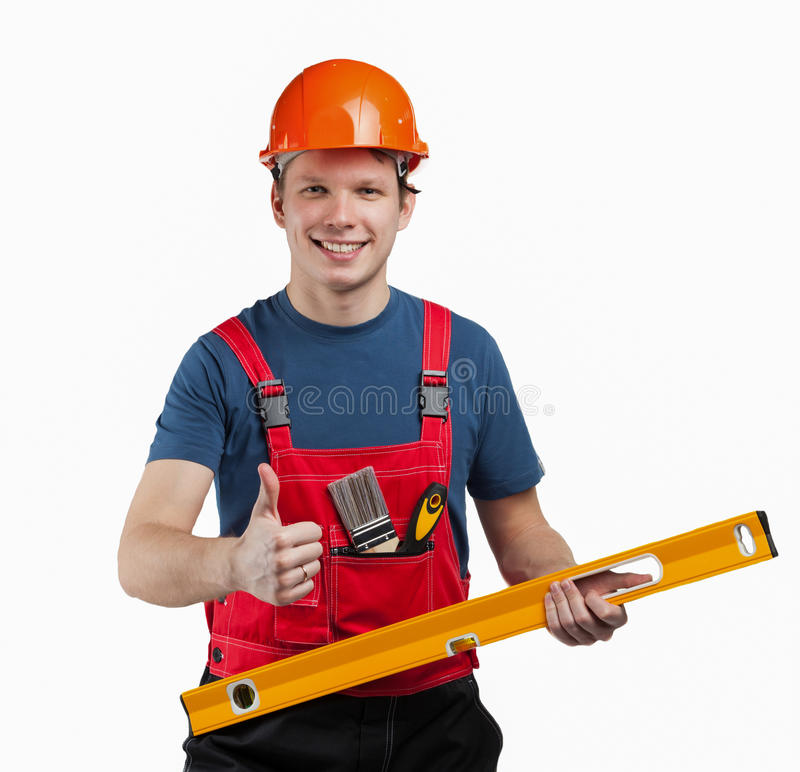 Trabajador de construcción alegre en uniforme imagen de archivo libre de regalías