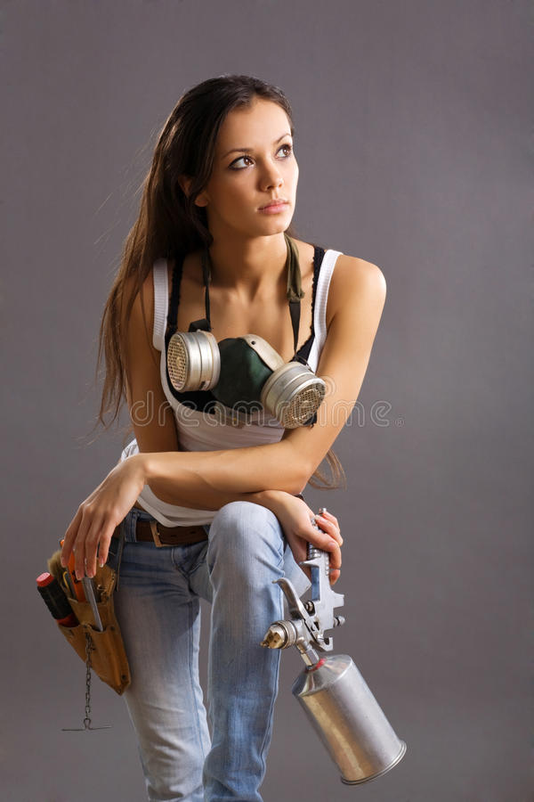 Trabajador de construcción atractivo de la mujer joven imagenes de archivo