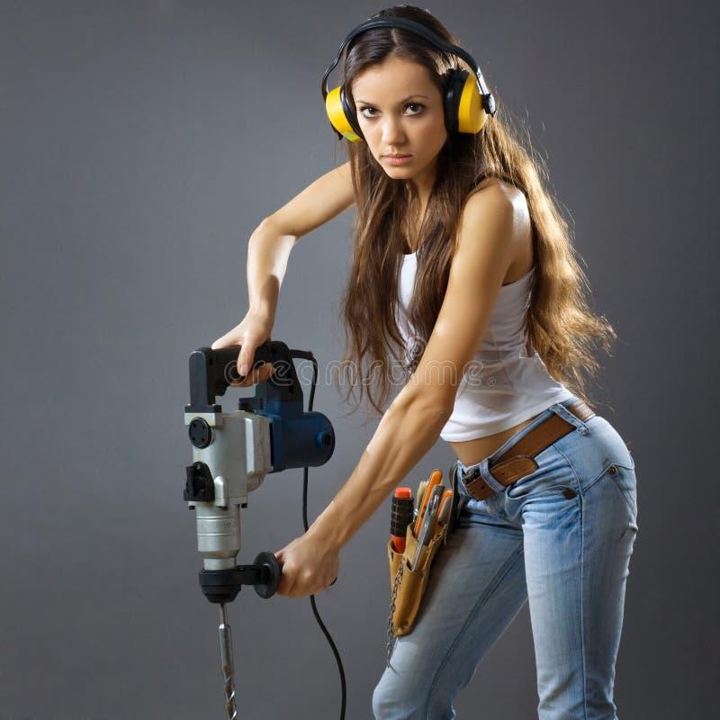 Trabajador de construcción atractivo de la mujer joven fotografía de archivo