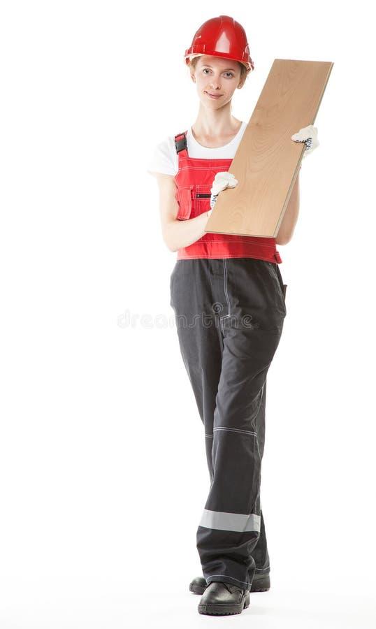 Trabajador de construcción con el laminado foto de archivo