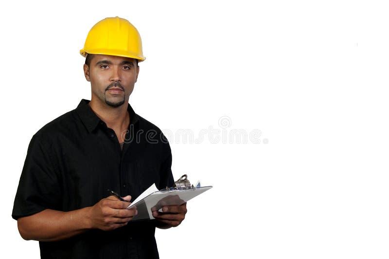Trabajador de construcción con el sujetapapeles imágenes de archivo libres de regalías
