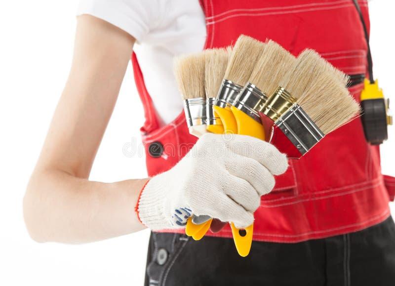 Trabajador de construcción con los cepillos foto de archivo libre de regalías