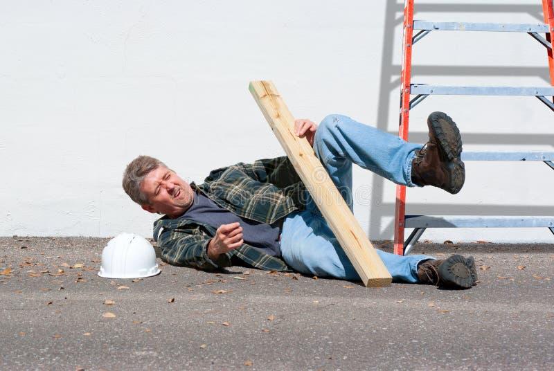 Trabajador de construcción dañado imagenes de archivo
