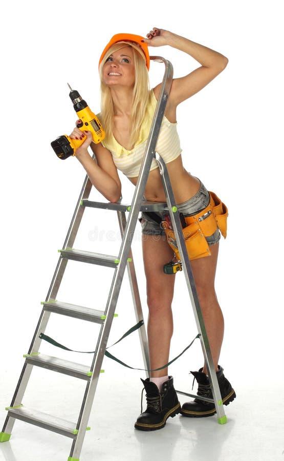 Trabajador de construcción de sexo femenino atractivo imagen de archivo