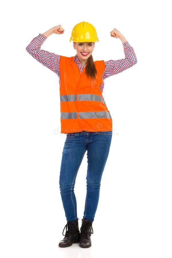 Trabajador de construcción de sexo femenino Cheering foto de archivo libre de regalías