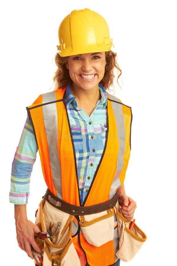 Trabajador de construcción de sexo femenino hermoso feliz foto de archivo