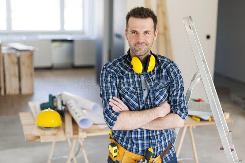 Trabajador de construcción hermoso foto de archivo