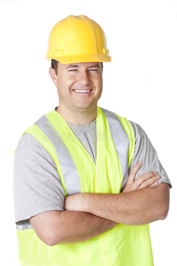 Trabajador de construcción hermoso sonriente imagenes de archivo