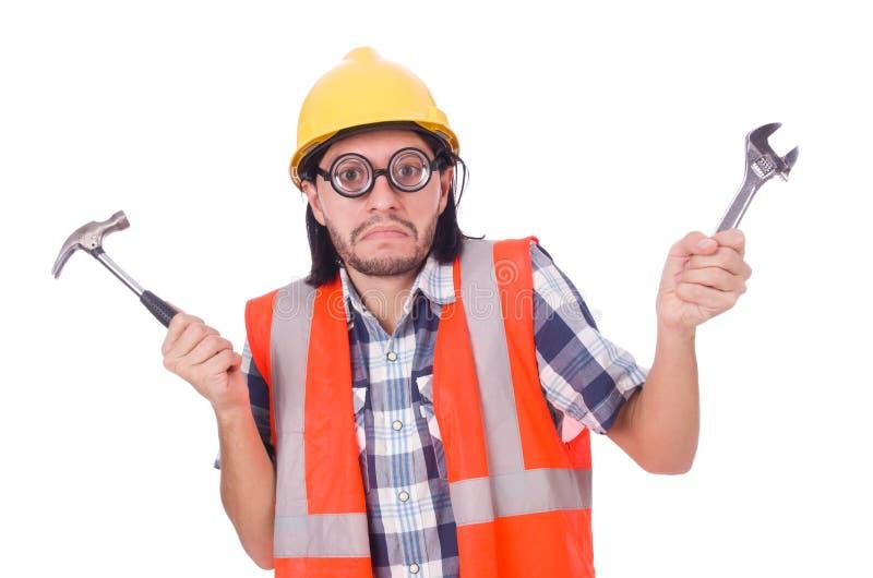 Trabajador de construcción joven divertido con el martillo y fotografía de archivo libre de regalías