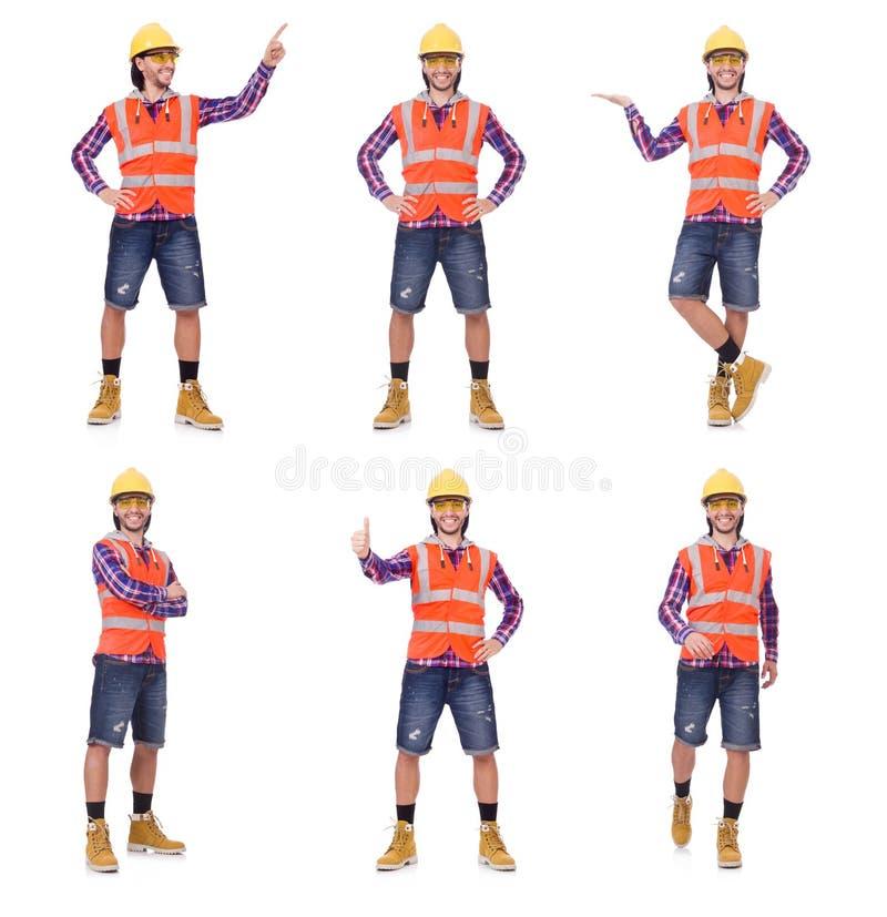Trabajador de construcción joven que presiona el botón vurtual aislado en wh foto de archivo