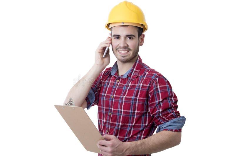 Trabajador de construcción que habla en el teléfono foto de archivo