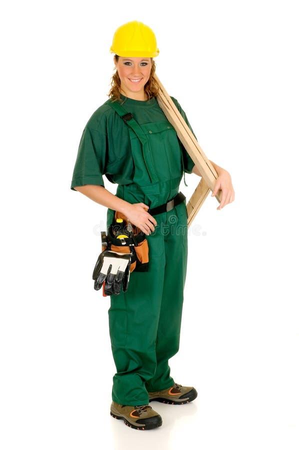 Trabajador de construcción, verde imagenes de archivo