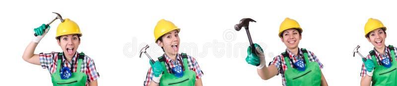 Trabajador de sexo femenino con el martillo aislado en blanco imagenes de archivo