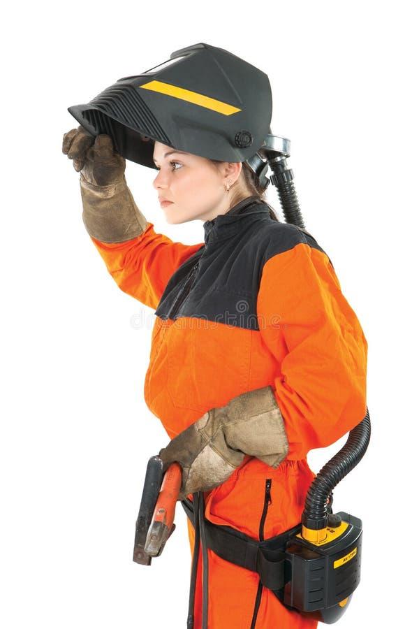 Trabajador del soldador de la muchacha en máscara de la soldadura foto de archivo libre de regalías