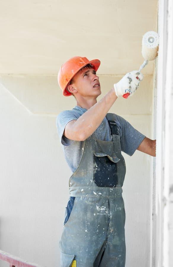 Trabajador del yesero de la fachada del constructor imagenes de archivo