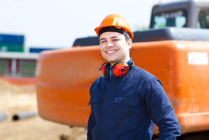 Trabajador en un emplazamiento de la obra foto de archivo