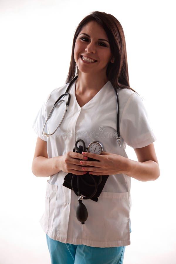 Trabajador hispánico bonito del cuidado médico de los años 20 fotografía de archivo libre de regalías