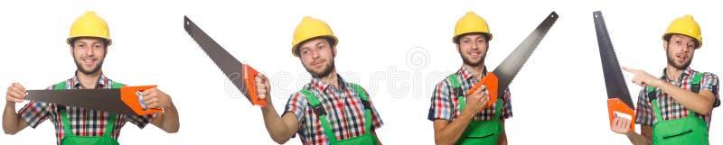 Trabajador industrial con la sierra aislada en blanco imagenes de archivo