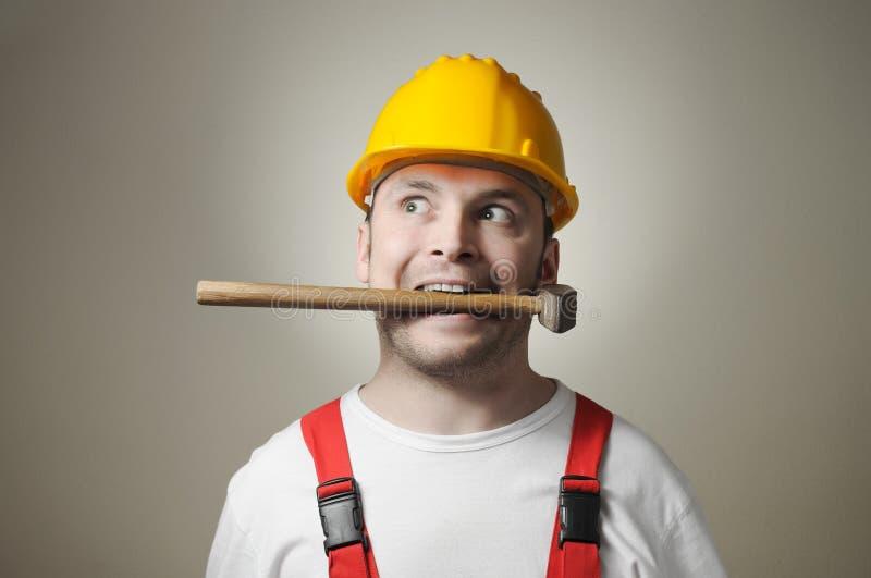 Trabajador joven insano fotografía de archivo