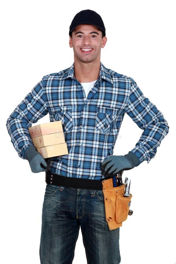 Trabajador manual con madera imágenes de archivo libres de regalías