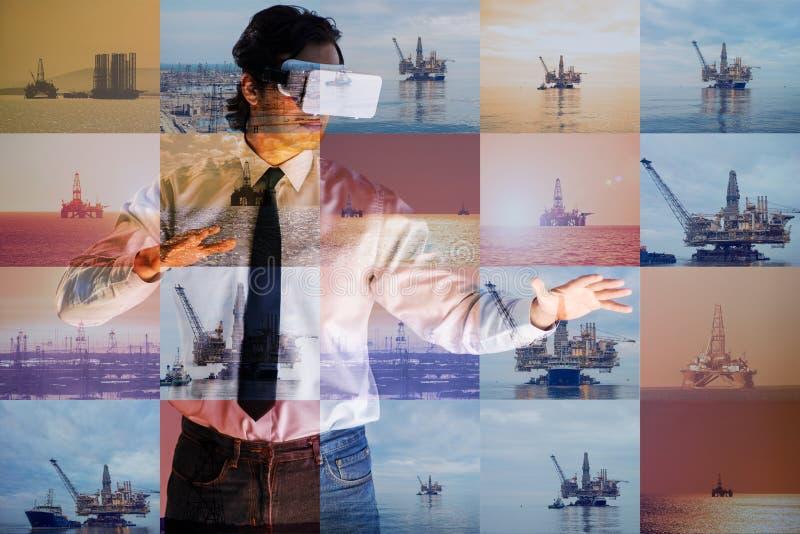 Trabajador petrolero en concepto de las operaciones remotas en industria de petróleo imagen de archivo libre de regalías