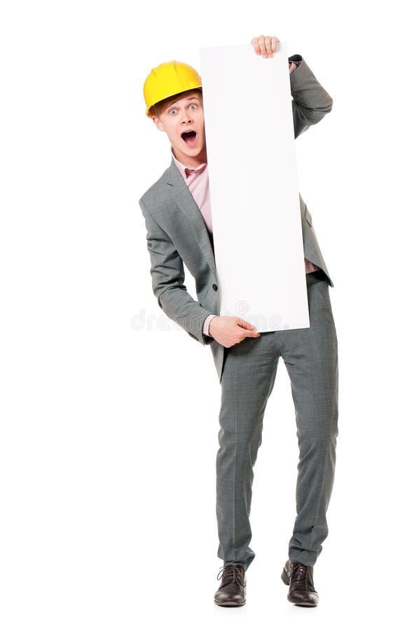 Trabajador que presenta al tablero en blanco fotografía de archivo