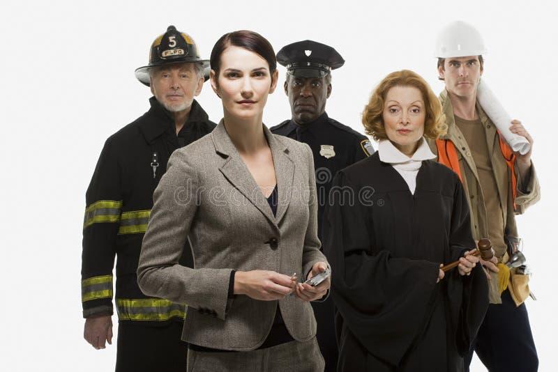 Trabajador y empresaria de construcción del juez del oficial de policía del bombero imágenes de archivo libres de regalías