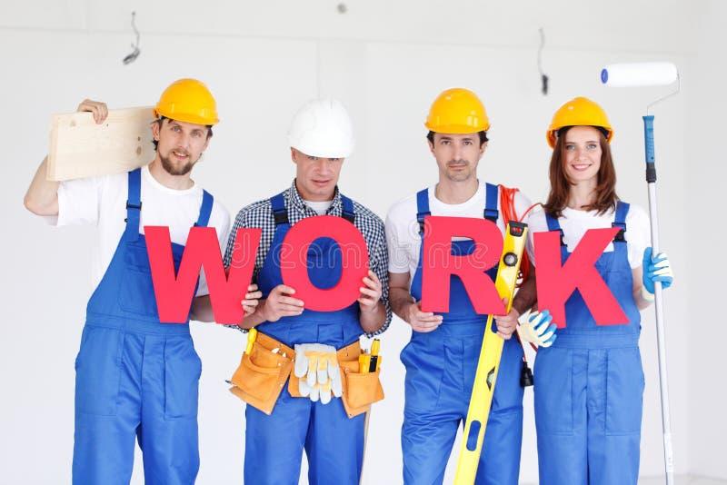 Trabajadores con el trabajo de la palabra foto de archivo libre de regalías