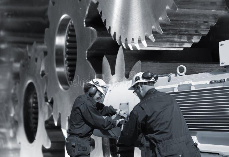Trabajadores de acero y engranajes foto de archivo libre de regalías