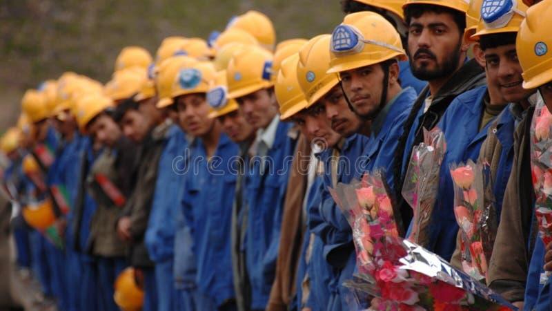 Trabajadores de cuello azul imagenes de archivo