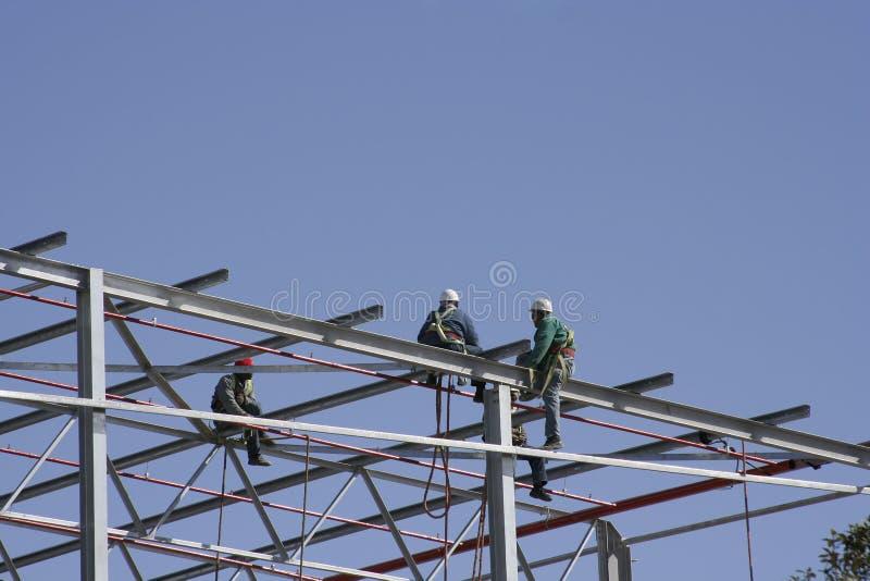 Trabajadores del cielo foto de archivo