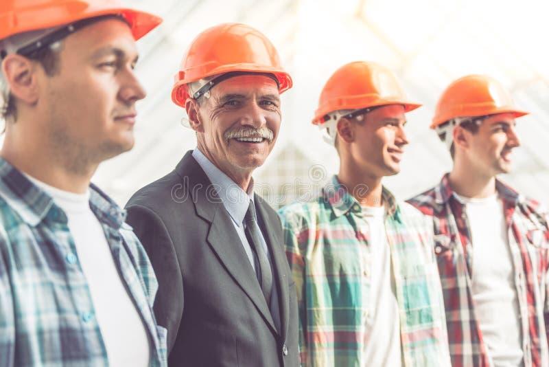 Trabajadores del sector de la construcción imágenes de archivo libres de regalías