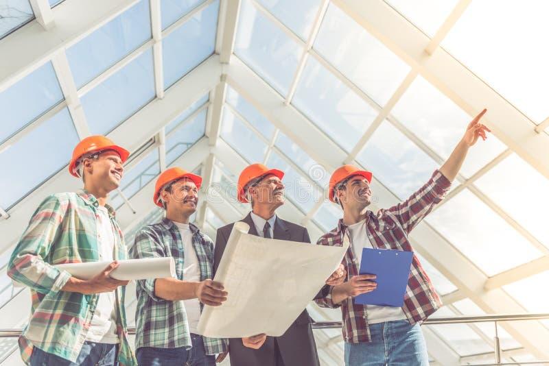 Trabajadores del sector de la construcción fotografía de archivo