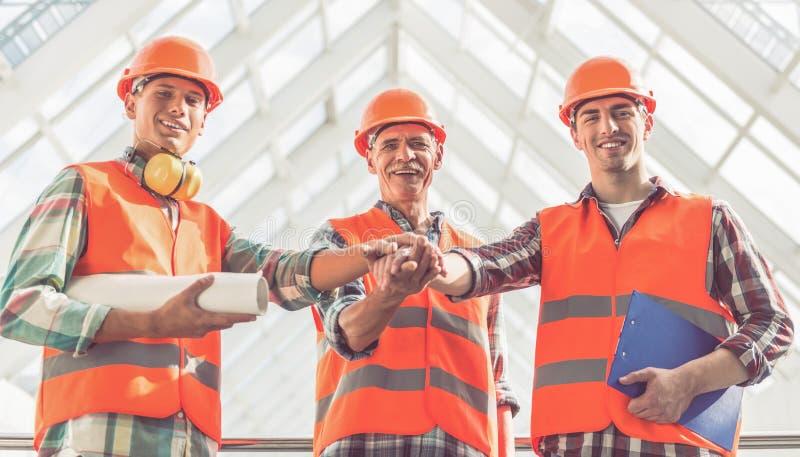 Trabajadores del sector de la construcción foto de archivo libre de regalías