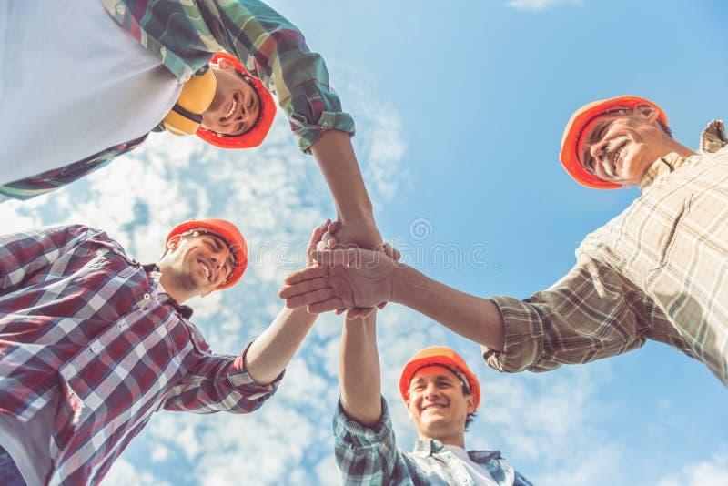 Trabajadores del sector de la construcción foto de archivo