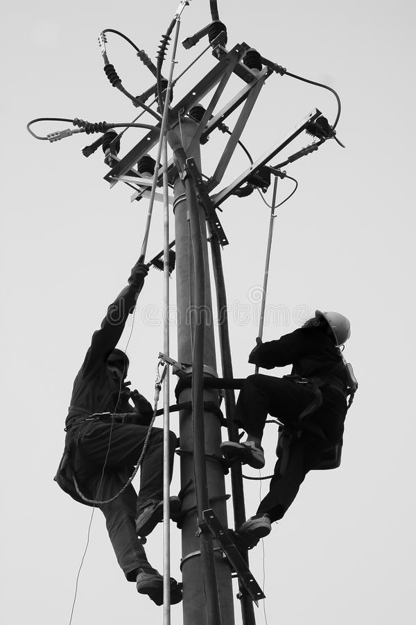 Trabajadores eléctricos foto de archivo