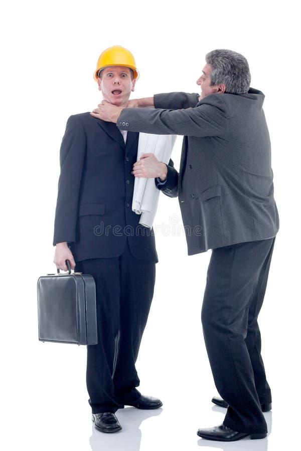 Trabajadores que estrangulan de Boss, concepto de los asuntos divertidos fotos de archivo