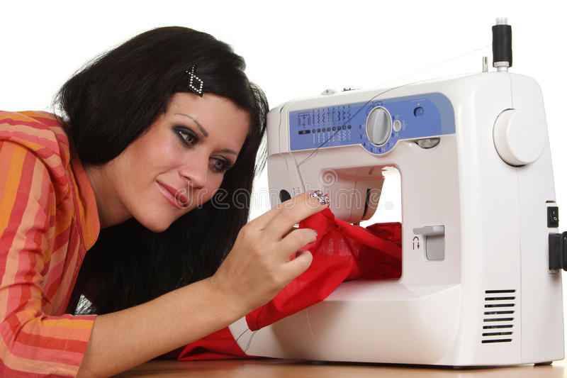 Trabajo de la costurera sobre la coser-máquina fotos de archivo