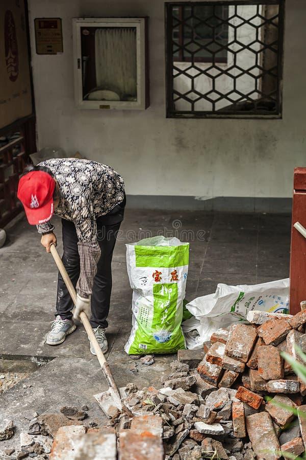 Trabajo de los trabajadores emigrantes foto de archivo
