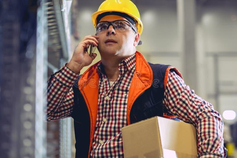 Trabajo difícilmente Trabajadores de Warehouse foto de archivo