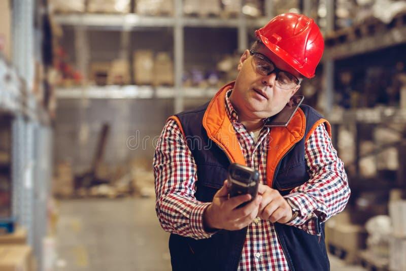 Trabajo difícilmente Trabajadores de Warehouse imagen de archivo libre de regalías